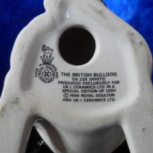 """A """"vintage"""" (1994) Royal Doulton / UK. I. Ceramics Ltd British bulldog - DA 228 (white) with black jacket. Limited edition of 1000. Height 5"""". Made in England. Base view showing the words """"Made in England"""". A """"vintage"""" (1994) Royal Doulton / UK. I. Ceramics Ltd British bulldog - DA 228 (white) with black jacket. Limited edition of 1000. Height 5"""". Made in England."""