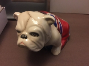 The ROYAL DOULTON 701587258333 NEW Jack the Bulldog a s 007 featured in the 2012 Bond film Skyfall and again in the 2015 Bond film SPECTRE is dissapointingly foreign made. Models of Bulldogs were first made by Royal Doulton in the 1940s and by this decade the breed had come to symbolise the steely determination of the British character. Unfortunately Royal Doulton have now chosen to make this modern version in Thailand. Front view.