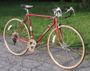 "A red Falcon Black Diamond road bike, designed by Ernie Clements and made in Lincolnshire, England of ""Tru-Wel electrical resistance welded steel tubes"". Made in England"