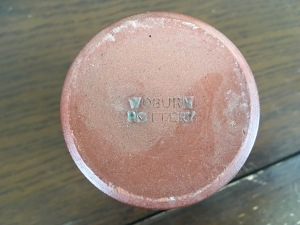 Woburn Pottery base stamp (on the base of one of the candle holders above).