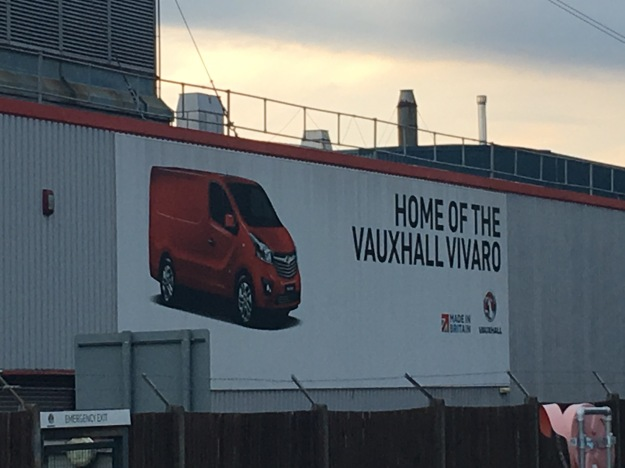 Luton, home of the Vauxhall Vivaro van. An advertising hoarding on the side of the Luton factory. 13 October 2016. Photograph by author.