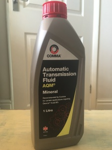 Comma automatic transmission fluid AQM, I litre. August 2016. Made in Great Britain. Photograph by author. Front view.