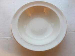 A vintage Nelson Ware white bowl. Produced in 1977 for HM forces. Photograph by author. Front view.