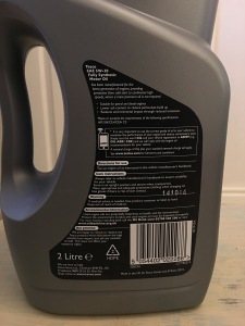 Tesco Motor Oil 5W-30 2L. Made in the UK. Photograph by author. Rear label detail view.