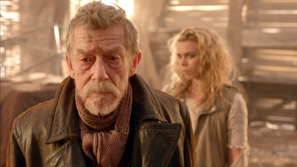 John Hurt (as Dr Who) and Billie Piper (as Bad Wolf) in Doctor Who, The Day of the Doctor, November 2013. John Hurt is sporting a handsome goatee.