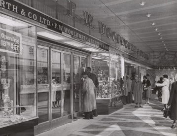 Woolworths Oxford, 1957. Customers taking a sneak peek through the windows of the new store before it opened.