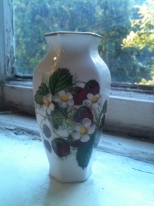 "A small Hammersley vase (about 5"" tall) with a wild strawberries design/ Marked on the base ""Bone China Hammersley Made in England"" with an acorn and a crown marking and the numbers ""20-3"". photograph by author."