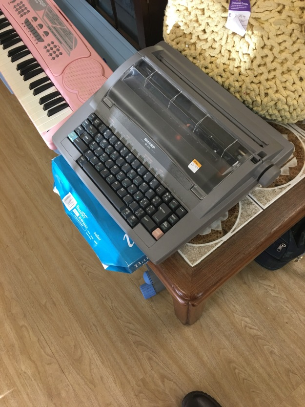 A Vintage made in the UK Sharp typewriter / word processor in a charity shop in March 2016. Photograph by author.