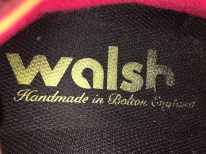 "Walsh Lostock Orange/Yellow/Red trainers. Made in England. Inside detail with the words ""Handmade in Bolton, England"" Photograph by author."