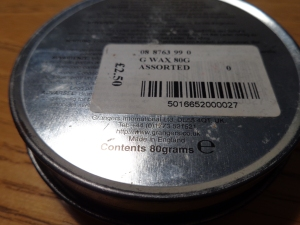 An older tin of Granger's G-Wax. Rear view, saying made in England.