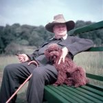 Winston Churchill wearing a wide brimmed hat (with his miniature poodle).