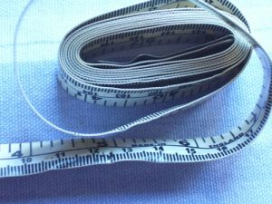 Vintage Tape Measure with brass ends by Dean. Made in England