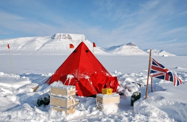 A Snowsled made in the UK Scott Pyramid Tent in use somewhere snowy with a Union Flag flying. Great photo this one.