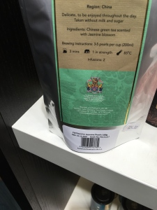 East India Company Jasmine Pearls Green Tea. Blended and packed in the UK. Rear of packaging label view.
