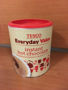Tesco Everyday Value Instant Hot Chocolate. Produced in the UK. Front of packaging view. Photograph by author.