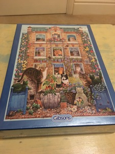 Gibsons Peeping Tom cat themed jigsaw puzzles, 500 pieces. Made in the UK and are labelled as such. Photograph by author. Front of box view.
