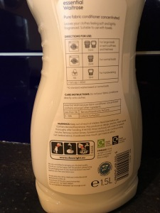 Essential Waitrose Pure Fabric Conditioner. Produced in the UK. Rear of bottle view.