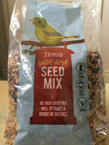 Tesco own brand wild bird seed. Produced in the UK. Front of packet view. Photograph by author.