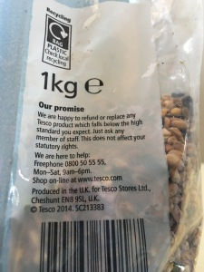 Tesco own brand wild bird seed. Produced in the UK. Rear of packet view. Photograph by author.