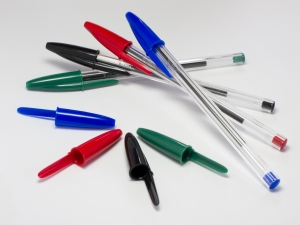 Four green, black, red and blue Bic Cristal pens and four additional caps. June 2012. These pens are made in France.
