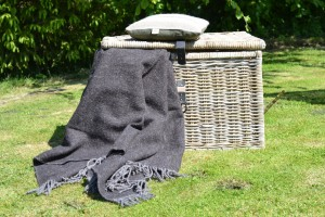 FelinFach traditionally woven Welsh heavyweight woollen blanket in grey herringbone, made from a blend of Welsh Black and Herdwick sheep wool. Made in the UK