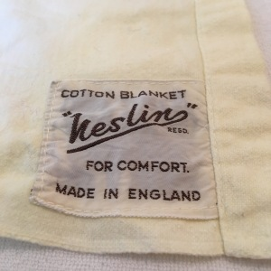 Neslin cotton blanket / sheet. Made in England. This company seems to have gone. I can't find any trace of them on the internet. Photograph by author.