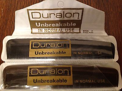Duralon unbreakable in normal use pocket-Combs. Made in England.