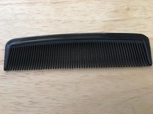 "Duralon 4"" (10cm) Small Grooming Comb. Very strong, flexible, unbreakable, soft edged teeth. British Made. Perfect for grooming your beard or moustache. In black. Photograph by author 21 Feb 2017."