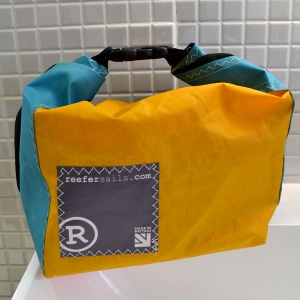 Reefer roll-top washbag, made from windsurf sailcloth, orange, purple, green. Made in Britain.