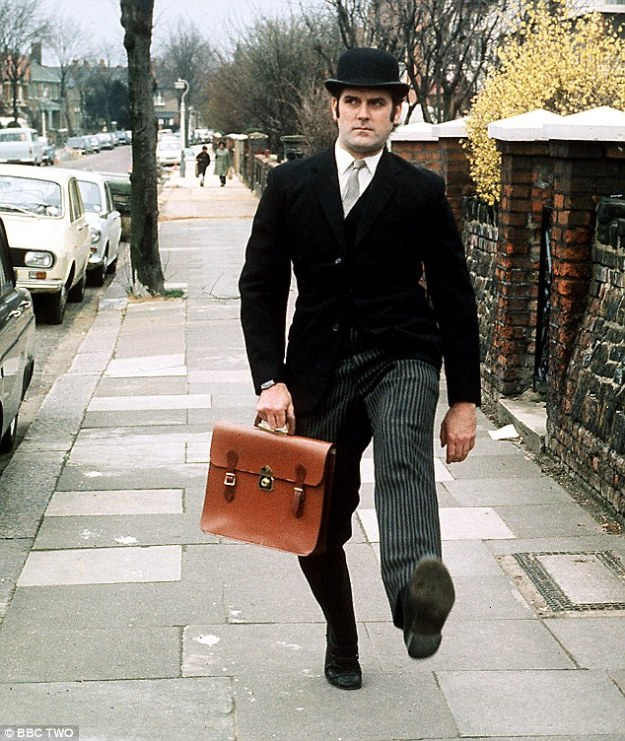 The bowler hat is also inextricably linked to the British 'City Gent', he wore it with a pinstriped suit, briefcase and tightly furled umbrella, although the City Gent look had died out by the late 1980s. The look was famously parodied by John Cleese in Monty Python's 1970 'Ministry of Silly Walks' sketch.