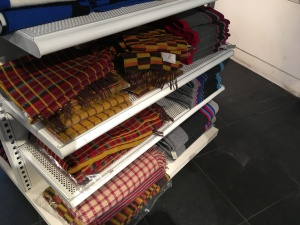Bronte by Moon scarves and Green Grove Weavers scarves for sale in the London Transport Museum Shop, 20th January 2016. Bronte by Moon scarves and Green Grove Weavers scarves are made in Great Britain.