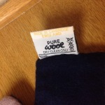 A Luke Eyres double-sided scarf. Made in Cambridge, England. View 2; made in England label.