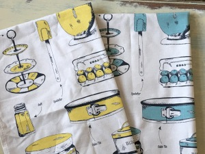 Victoria Eggs made in the UK teal (blue) and yellow coloured Baking Delight Tea Towel Towels. Photograph by author.
