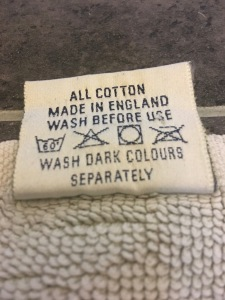 An old Fired Earth floor made in England floor towel, rear of label detail. Photograph by author. Sadly this company no longer have their towels made in the UK.