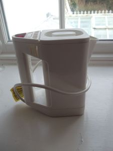 Boots travel electric kettle 17cm high. Made in Britain.