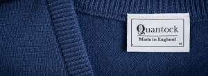 Quantock petrol blue v-neck jumper, label detail. Made in England.