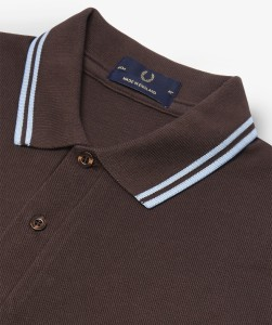 Made in England, the Fred Perry M12 shirt. Label detail on colour 103: Chocolate/Ice/Ice
