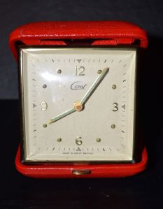A vintage made in Great Britain travel alarm clock by a company called Coral.