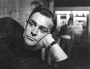 Production picture of Sir Sean Connery wearing the Rolex 6538(A) on nylon strap, Goldfinger, 1964