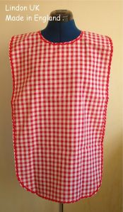 ADULT BIB - RED GINGHAM – RIC RAK TRIM – VELCRO NECK FASTENING - MADE IN ENGLAND BY LINDON UK.