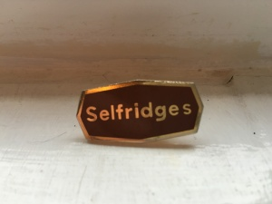 A Selfridges (Oxford) Ltd staff badge.