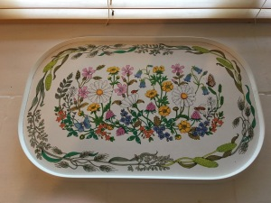 A vintage melamine covered tray from St Michael (Marks and Spencer). Wild flowers design. Made in the U.K. Top view. Photograph by author.
