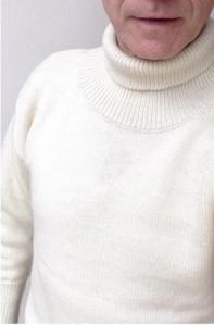 Grey Fox wearing a Crystal Knitwear submariner's roll neck jumper,