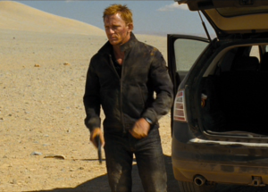 One of Daniel Craig's most popular outfits in Quantum of Solace is his jacket in Bolivia. The dark navy cotton, zip-front jacket is by Tom Ford. Ford's inspiration came from the G4 Harrington jacket by Baracuta, who have made Harrington jackets for over half a century. The jacket has cuffs and a waistband that adjust with buttons. There are slash pockets on the sides that close with buttons. Sadly though the jacket was made in Italy not England.