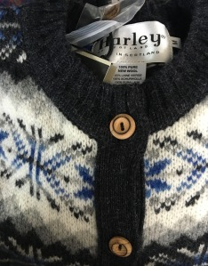 A made in Scotland Harley of Scotland cardigan on sale in the gift shop at Inverness Airport. Photograph by author.