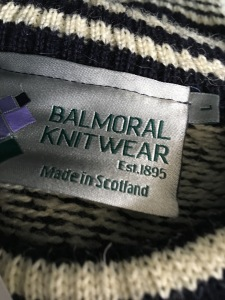 A made in Scotland Balmoral Knitwear jumper on sale in the gift shop at Inverness Airport. Photograph by author.