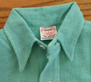 A vintage child's Aertex shirt from the Cellular Clothing Company, circa 1950s.