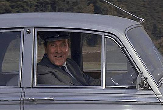 "Patrick Macnee in A View to a Kill playing Sir Godfrey Tibbett and posing as his chauffeur, 1985. Interestingly Honor Blackman played Pussy Galore in Goldfinger; Diana Rigg played Teresa di Vicenzo in On Her Majesty's Secret Service; and Jonanna Lumley also played in a Bond girl in On Her Majesty's Secret Service (in which she had two lines as a British girl among the villainous Ernst Stavro Blofeld's ""Angels of Death"")."