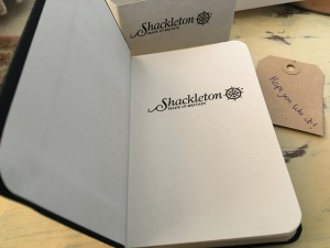 "Shackleton woven cloth black octavo pocket sized notebook. Flyleaf saying ""Shackleton Made in Britain"". Photograph by author."